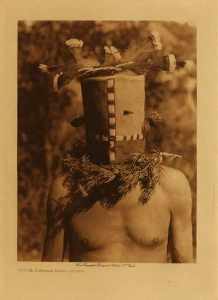 http://www.firstpeople.us/photos/Tyooni_Shiwanna_mask_Cochita.html.  Tyooni_Shiwanna_mask_Cochita, by Edward S. Curtis